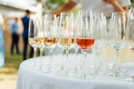 A row of empty champagne glasses on table. Banquet setting 写真素材