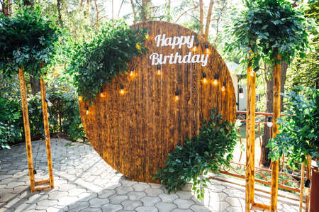 Round wooden arch, photo zone for a photo shoot for a 50th anniversary man
