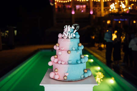 Big and delicious pink and blue baby gender reveal party cake