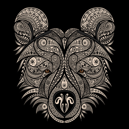 The head of a bear. Vector drawing of an animal from vintage patterns.