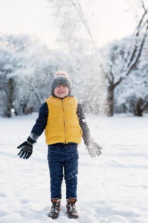 threw: boy threw the snow and it falls on his head