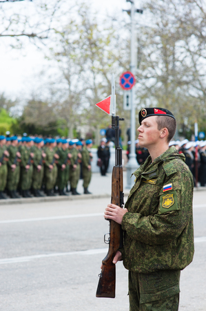 annexation: Russian soldier with a gun on parade in honor of the victory Stock Photo