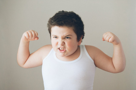 evil fat boy showing muscles and teeth