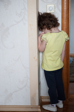 surly: girl standing in the corner and cry
