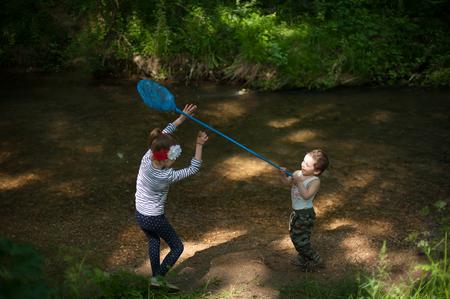 wants: little boy wants to hit a net on girl