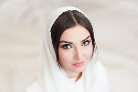 portrait of beautiful girl in white headscarf Stock Photo