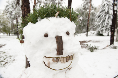 bad ugly white snowman in park at halloween Stock Photo