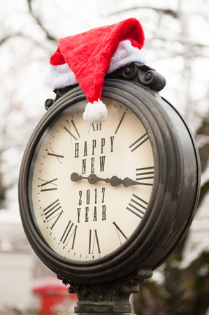 numeros romanos: vintage clock with santa hat and words Happy New Year 2017