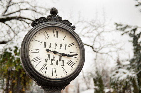 vintage clock with title Happy New Year at winter