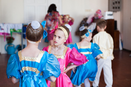group of children in russian colorful ethnic costume before concert show
