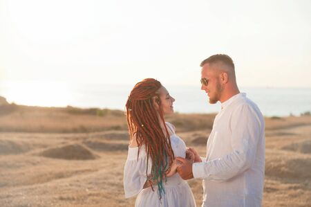 beautiful trendy loving young caucasian couple in summer sunset Stok Fotoğraf