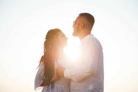 beautiful happy loving young man with dreadlocks and bearded man together in summer sunset Stok Fotoğraf