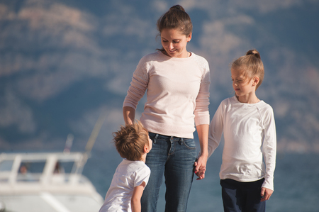 happy family smiling emotions on sea shore outdoors Stok Fotoğraf
