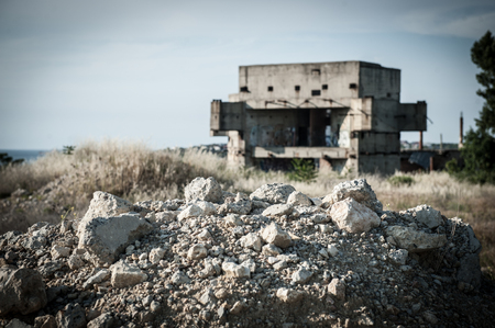 ruins of building construction in war conflict or natural disaster zone with copyspace
