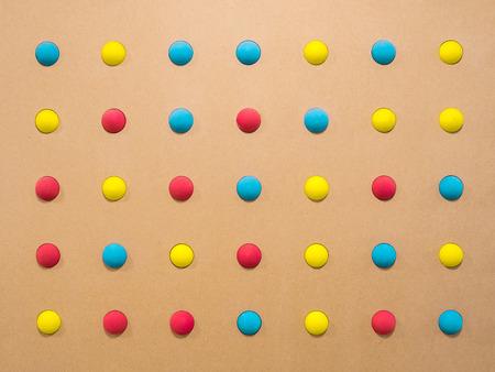 abstract background of colored toy balls symmetrically arranged relative to each other. vivid back burner to advertise childrens games - Image