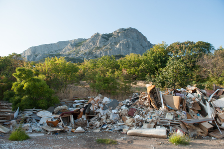 garbage lying outdoors in green park on rock mountain background Stok Fotoğraf - 122665162