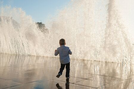 panic of child escaping from huge high wave during storm weather in city Stok Fotoğraf