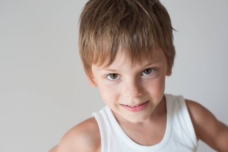 happy adorable cheerful little kid in white tank top Reklamní fotografie