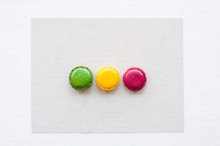 tasty beautiful nutrition colorful macaron red yellow green cookie cracker lying on gray tablecloth