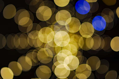 beautiful yellow and blue garland light blur bokeh color wheel ring background for merry christmas holiday eve background