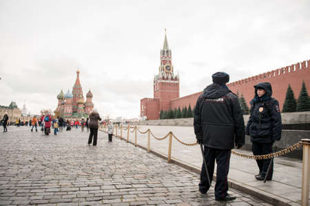 female and male police cops on red square in russia moscow among tourists , 1 December 2020