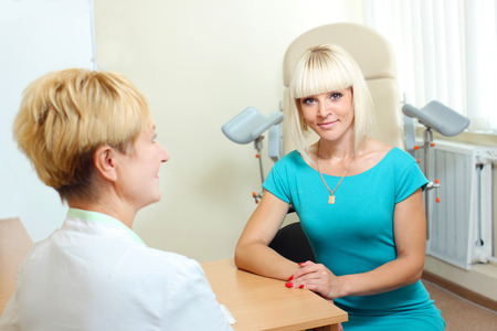 gynecological: Woman patient talking to a gynecologist gynecology office. Woman in doctors appointment Stock Photo