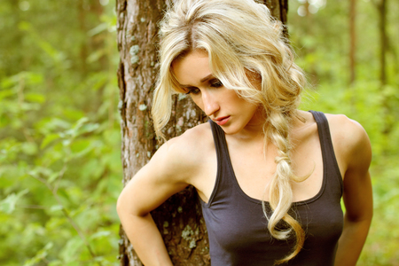 nice blond girl in the woods photo