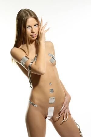 Nude girl in the original silver bikini