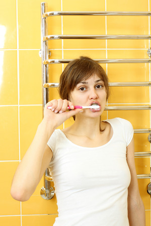 bikini construction: Girl in pajamas brushing her teeth