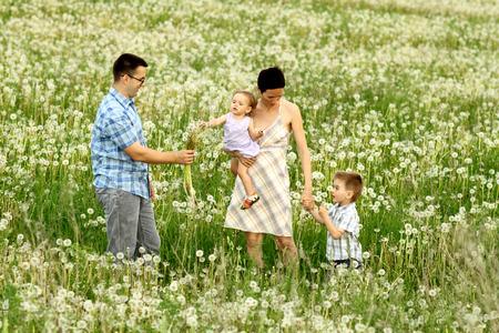 happy positive family among the dandelions photo