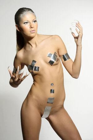 futuristic woman: Nude girl in the original silver bikini