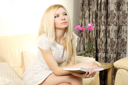 easy going: Nice natural blonde girl reading a book