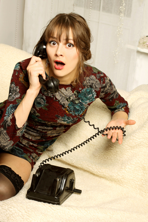 circumstances: Girl in evening dress emotional talking on old phone