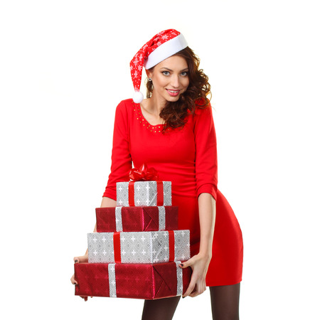 hristmas: hristmas, winter, happiness, holidays and people concept- smiling woman in santa helper hat with gift box. beautiful sexy girl wearing santa claus clothes Stock Photo