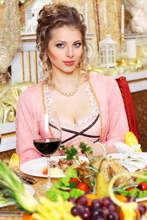 Girl in vintage dress in the restaurant. Elegant pretty woman in vintage evening dress waiting alone at the restaurant bar photo