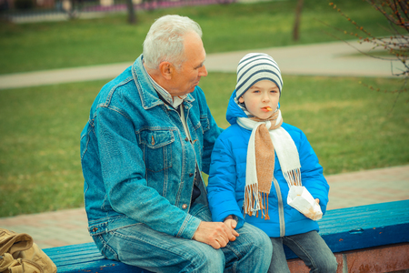 indulge: Grandfather and grandson eating fries and indulge