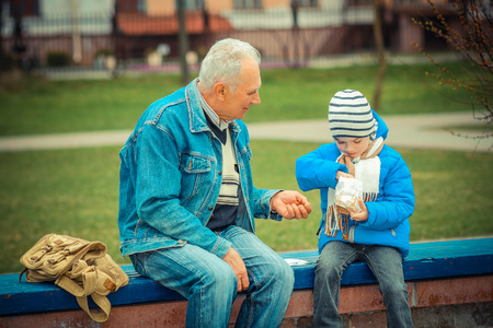 indulgere: Grandfather and grandson eating fries and indulge