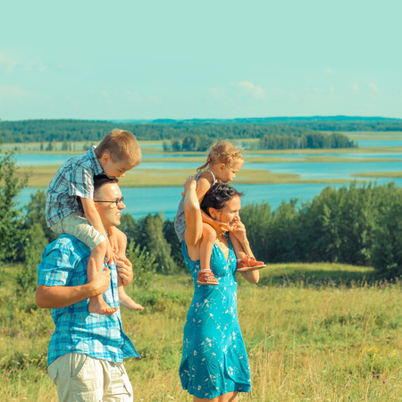 happy family nature: young beautiful family of four  Stock Photo