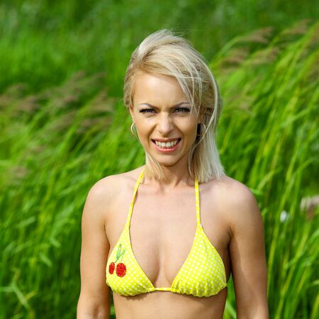 tanned woman: Pretty young sexy tanned woman in bikini posing outdoor in summer