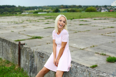 rejoices: cute blonde positive hipster girl. happy and emotional girl rejoices