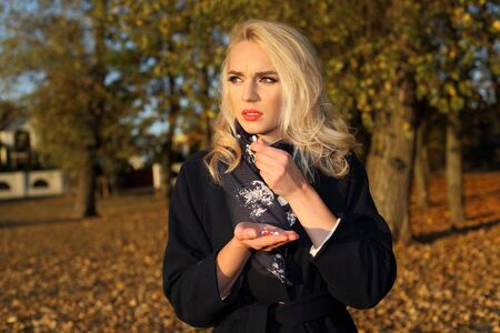 sad unhappy girl with pills outdoors in autumn