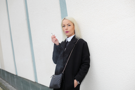neurosis: Portrait of a business woman nervously smoking Stock Photo