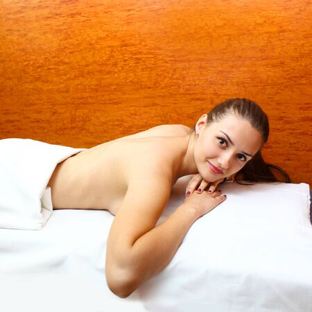 revitalize: Relaxed young woman laying on massage table Stock Photo