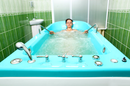 hydromassage: A girl and a hydromassage. She receives medical treatments for relaxation.