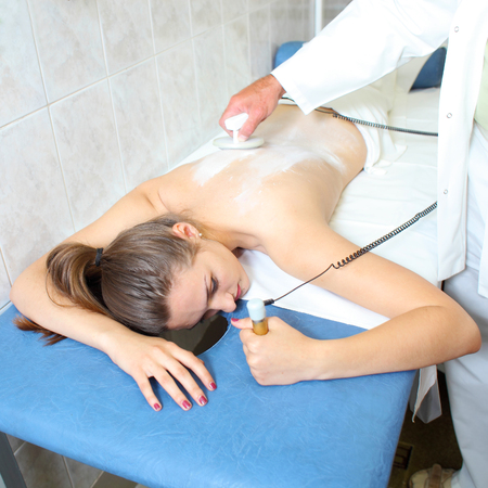 beauty center: Apparatus massage for women in the medical beauty center. beauty treatments for women Stock Photo