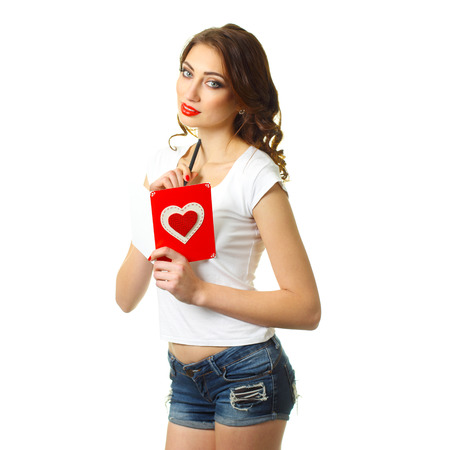 Attractive young woman with card on Valentine Day. Young romantic girl with Valentines card. Attractive hipster girl with love letter