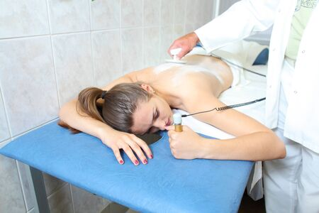 electrophoresis: Apparatus massage for women in the medical beauty center. beauty treatments for women Stock Photo