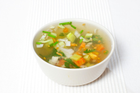 stainless steel pot: chopped soup ingredients: carrots, onions and celery cooking in a stainless steel pot Stock Photo
