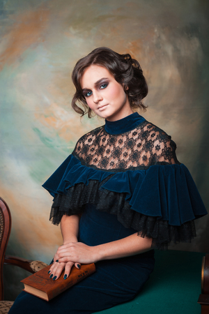 the caucasian beauty: Portrait of a cute teenage girl in a vintage dress. Stock Photo
