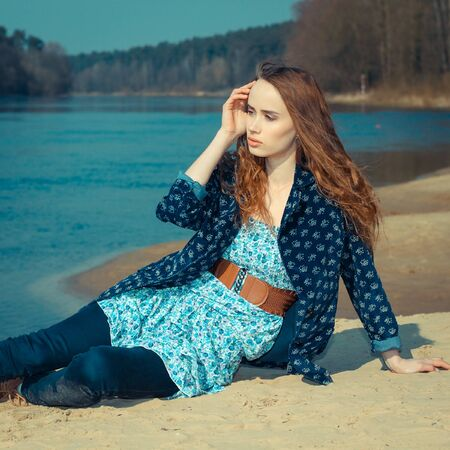 woman resting: Dreamy lonely hipster girl on the sand. beautiful hipster girl Stock Photo